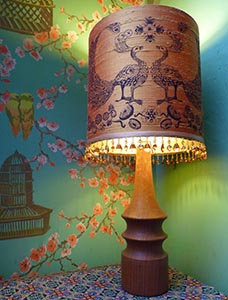 peacock lampshade lit